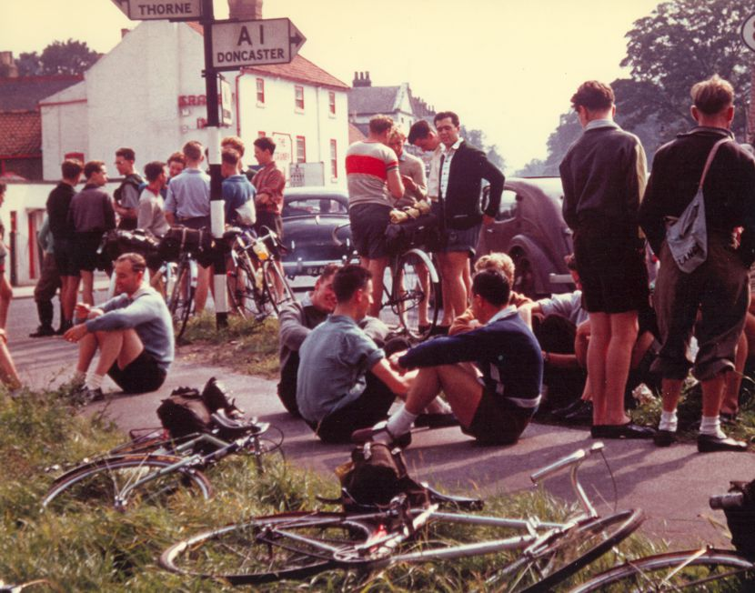 Image of Tom Simpson seated centre, with local cyclists on part of the Tom Simpson Retro Ride route in 1955